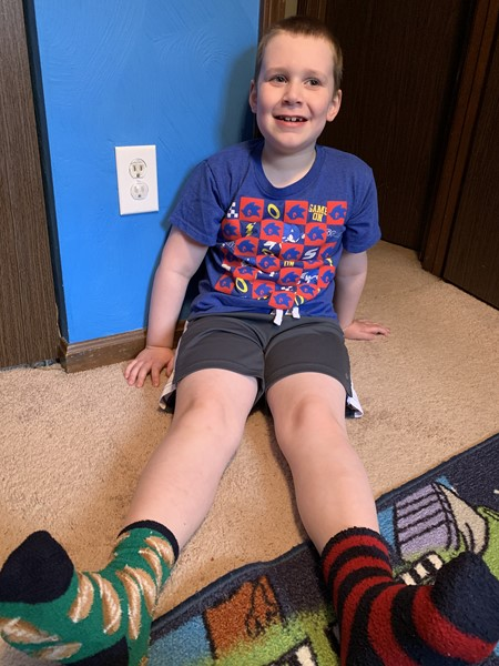 Male students wearing unique socks for World Down Syndrome  Day.